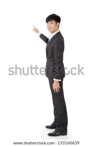 Asian businessman introduce by hand, full length portrait isolated on white background.