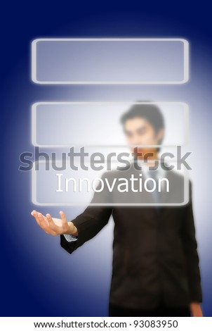 Asian businessman pushing innovation word.