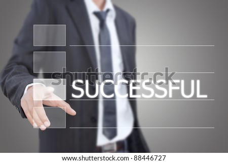 Asian businessman pushing successful word on a touch screen interface.