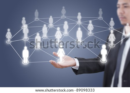 Asian businessman putting people social network. - stock photo