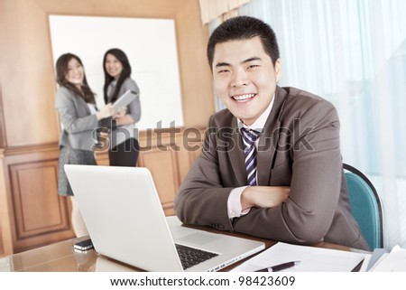 Asian businessman smiling to camera in the office