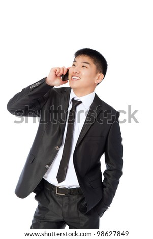 Asian businessman talking on mobile cell phone, happy smile looking up, using cellphone, handsome young business man phone call, wear elegant suit isolated over white background
