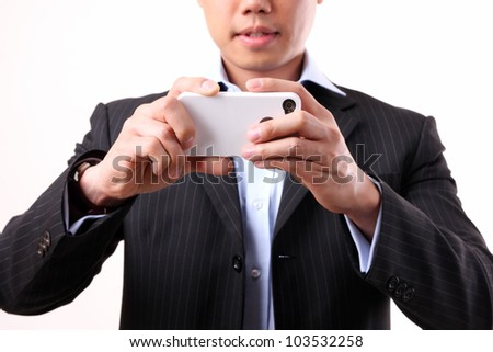 Asian businessman using a mobile camera on the white background