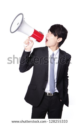 asian businessman using bullhorn with energetic face