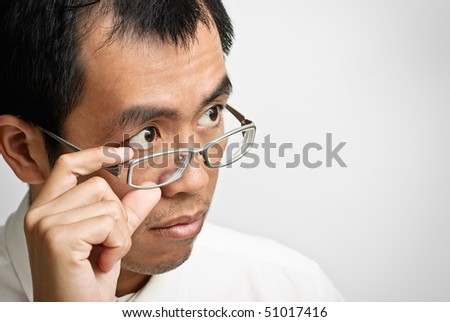 Asian businessman watch and put hand on glass.