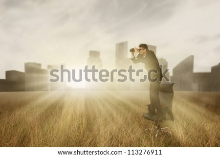 Asian businessman with binoculars looking for a good opportunity