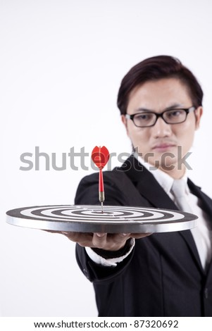 Asian businessman with bull's eye isolated on white