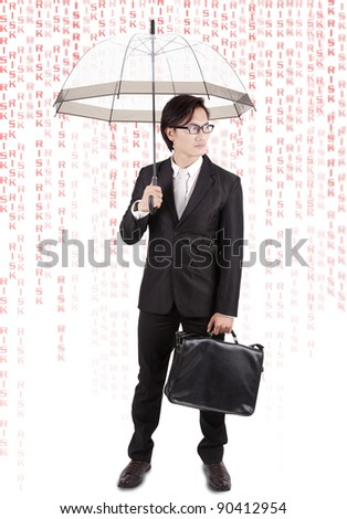 Asian businessman with umbrella