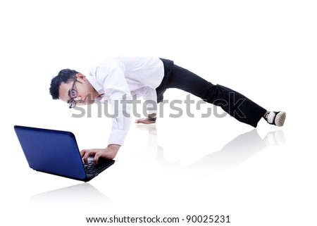 Asian businessman working and breakdancing isolated on white