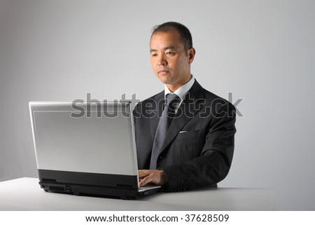 asian businessman working with laptop