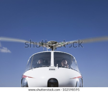 Asian businessmen in helicopter