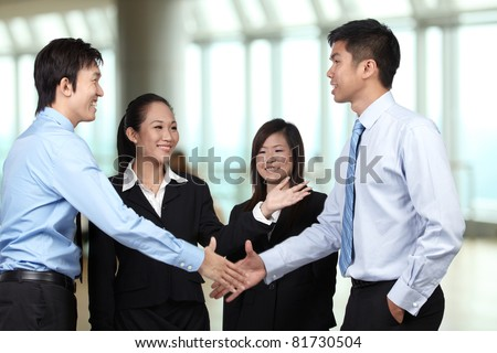 Asian Businessmen shaking hands