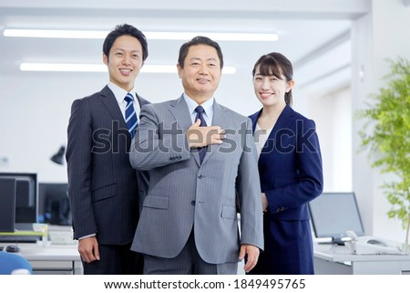 Asian businessmen smiling at the office Сток-фото ©