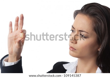 Asian Businesswoman checking medicine closely on white background