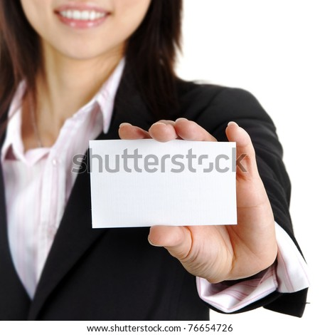 Asian businesswoman holding a blank business card and smiling at the camera