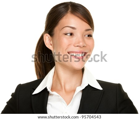 Asian businesswoman looking to the side smiling in black suit. Young female professional in her twenties isolated on white background. Multicultural mixed Caucasian and Chinese Asian.