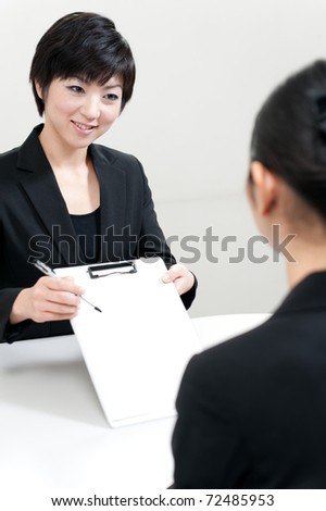 asian businesswoman making contract