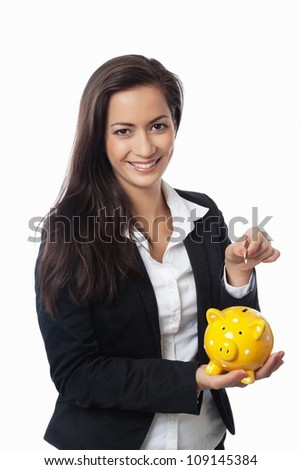 Asian Businesswoman putting money into piggy bank isolated on white