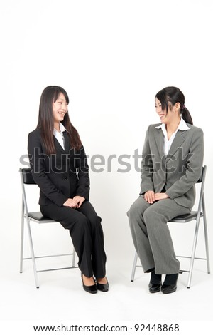 asian businesswoman sitting isolated on white background