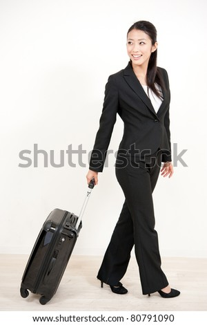asian businesswoman with suitcase
