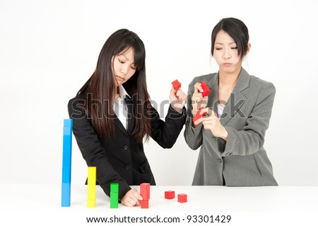 asian businesswomen in trouble with bar graph made of building block