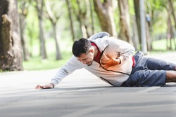 Asian cardiac arrest running young man heart attack in park.Severe heartache,First aid to people with heart disease.