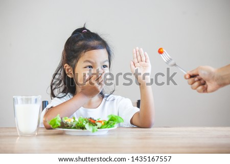 Asian child does not like to eat vegetables and refuse to eat healthy vegetables Photo stock ©