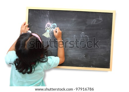 Asian child drawing with chalk at the blackboard.  isolated on white background