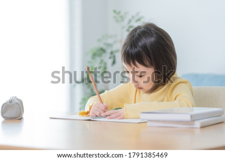 Asian child studying in the room   Сток-фото ©