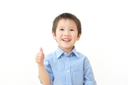 Asian child thumbs up gesture