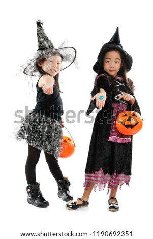 Asian children wearing halloween costume standing over white background 2a4b6232c9ed