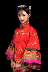 Asian Chinese ancient women wearing red clothes in black background