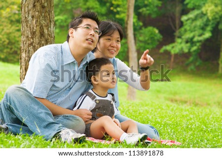 Asian Chinese family having fun at outdoor park