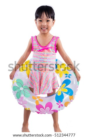 86921cc7a9fe8 Asian Chinese little girl portrait wearing swimsuit with swim ring in isolated  white background.