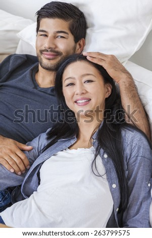 Asian Chinese man woman romantic couple laying back relaxing
