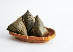 Asian Chinese Rice Dumpling, Zongzi isolated on white background. Usually taken during festival occasion.