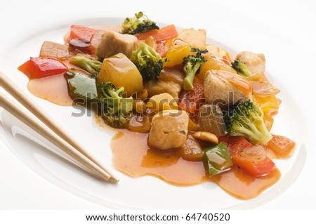 Asian chop suey with chicken and vegetables close up