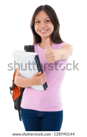 Asian college student thumb up standing isolated on white, focus on thumb.
