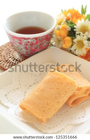 asian confectionery, egg roll with coconut and sugar inside on elegant dish