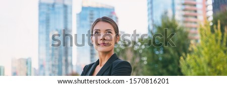 Asian confident business woman looking up to the bright future of her career opportunities. Job, work aspirational banner panorama background. Businesspeople lifestyle. Сток-фото ©