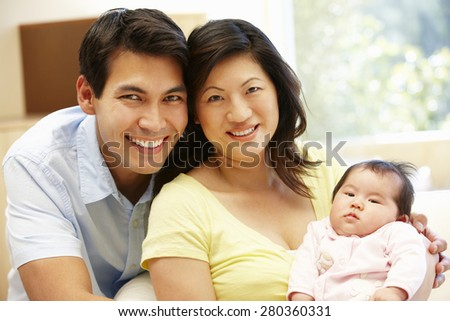 Asian couple and baby