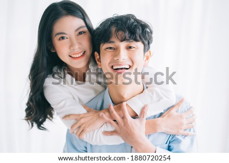 Asian couple happily embracing each other  Сток-фото ©