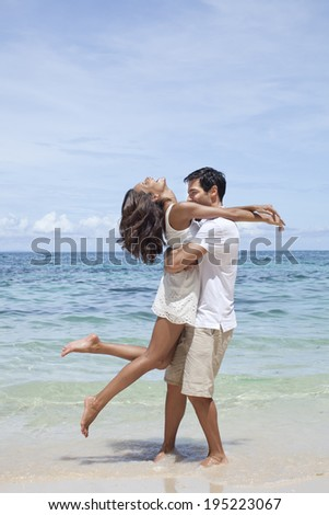 Asian couple hugging by the sea in Boracay in Philippines