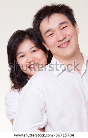 Asian couple hugging white shirt on white background