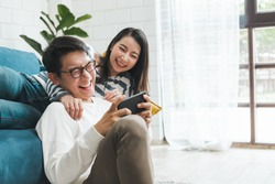 Asian couple man and woman talking working  spend time together at home, Asian couple family lifestyle concept