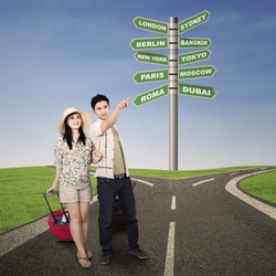 Asian couple pointing direction with road signs background, shot outdoor