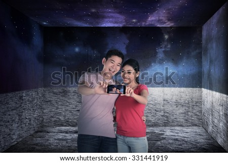Asian couple take selfie on the room like outer space