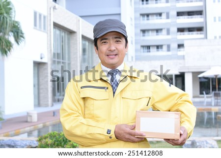 Asian courier delivering a package