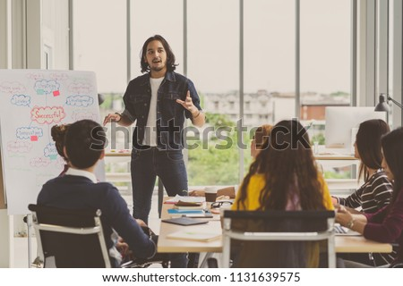 Asian Creative manager man presenting the successful ideas in front of Group Of Asian Business people with casual suit in serious action in the modern workplace, Group people business concept