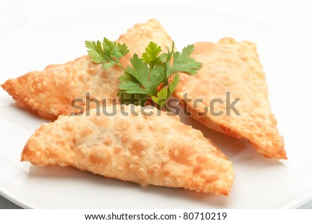 Asian cuisine- chebureki ? pasties isolated on white background decorated with dill